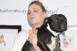 See Kaley Cuoco and Her Grumpy Pit Bull Friend Strike a Pose