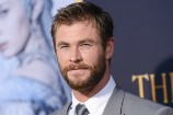 WATCH: A Shirtless Chris Hemsworth Gets Attacked by a Dog