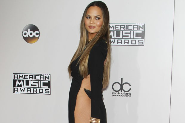 Chrissy Teigen Hilariously Claps Back at Haters Over Dress | Celebuzz