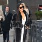 """AG_162991 -  - New York, NY - Kim Kardashian steps out in a classy gray fur coat over a white cleavage revealing jumpsuit, starting her morning on the wet streets of the """"Big Apple"""".  AKM-GSI 17 JANUARY 2017  To License These Photos, Please Contact :   Maria Buda  (917) 242-1505  mbuda@akmgsi.com  or    Mark Satter  (317) 691-9592  msatter@akmgsi.com  sales@akmgsi.com"""