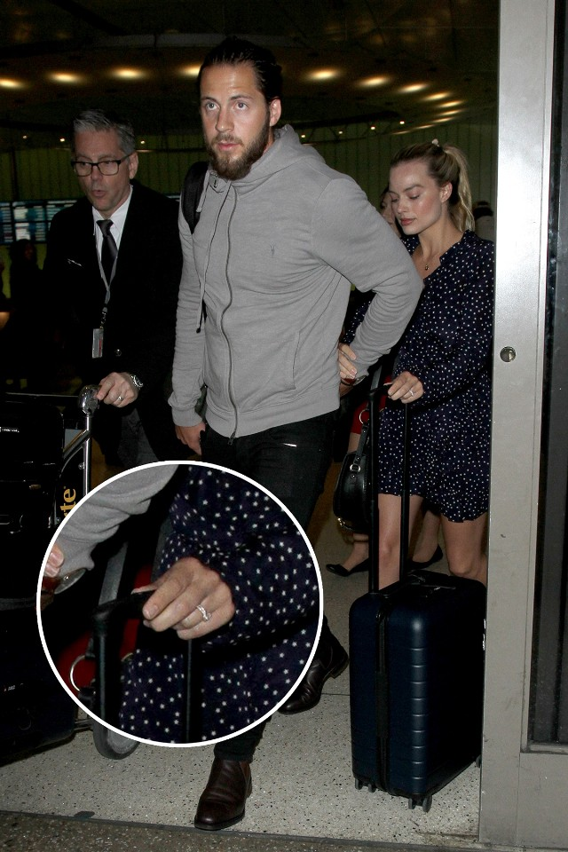 Margot Robbie and Tom Ackerley are a cute couple holding hands arriving at LAX Airport