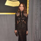 Chrissy Teigen on the red carpet at the 59th annual Grammy Awards