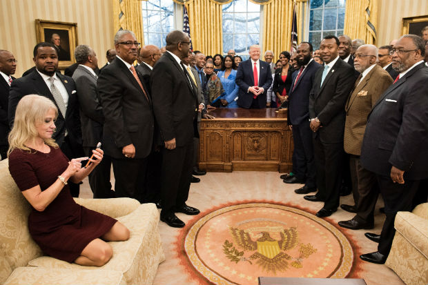 Kellyanne Conway kneeling shoes feet heels on couch sofa oval office