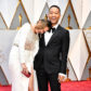 Chrissy Teigen and John Legend on the red carpet of the 2017 Academy Awards