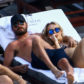 scott disick beach pool pda cuddle mystery blonde woman girl bikini cheating