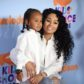 Model Blac Chyna (R) arrives for the 30th Annual Nickelodeon Kids' Choice Awards, March 11, 2017, at the Galen Center on the University of Southern California campus in Los Angeles.  Child at left is unidentified. / AFP PHOTO / VALERIE MACON        (Photo credit should read VALERIE MACON/AFP/Getty Images)