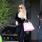 52352992 Reality star Khloe Kardashian is spotted leaving a studio in Los Angeles, California on March 22, 2017. Khloe was rocking an all black ensemble paired with a pink purse during the outing. FameFlynet, Inc - Beverly Hills, CA, USA - +1 (310) 505-9876