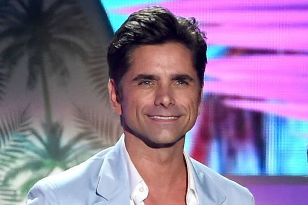 john stamos wardrobe malfunction pants split hole rip