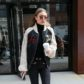 New York, NY  - Gigi Hadid and her sleek hair style spotted exiting her NYC apt wearing a cool looking Tommy Hilfiger jacket with black trousers and black boots.  Pictured: Gigi Hadid  BACKGRID USA 11 MAY 2017  BYLINE MUST READ: INI / BACKGRID  USA: +1 310 798 9111 / usasales@backgrid.com  UK: +44 208 344 2007 / uksales@backgrid.com  *UK Clients - Pictures Containing Children Please Pixelate Face Prior To Publication*