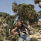 LAKE BUENA VISTA, FL - MAY 09:  In this handout photo provided by Disney Parks, Tennis superstar Serena Williams channels her inner Na'vi during a sneak peek at Pandora - The World of Avatar at Disney's Animal Kingdom on May 9, 2017 in Lake Buena Vista, Florida.  Williams, the world's No. 1-ranked player and reigning Australian Open champion, explored the newest themed land opening May 27 at Walt Disney World Resort, which immerses guests in a mystical world of massive floating mountains, bioluminescent rainforests and two breathtaking new attractions, Na'vi River Journey and Avatar Flight of Passage.  (Photo by David Roark/Disney Parks via Getty Images)