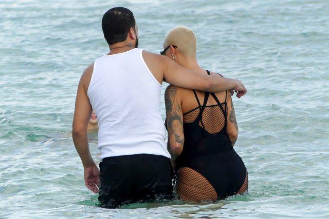 amber rose french montana hug pda beach swimsuit butt