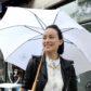 Olivia Wilde umbrella rain