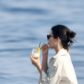 Kendall Jenner drinks on a paddleboard
