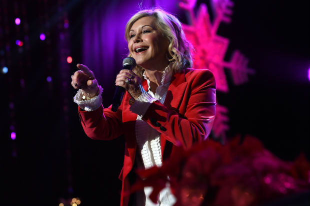 Olivia Newton-John says she has breast cancer; cancels tour