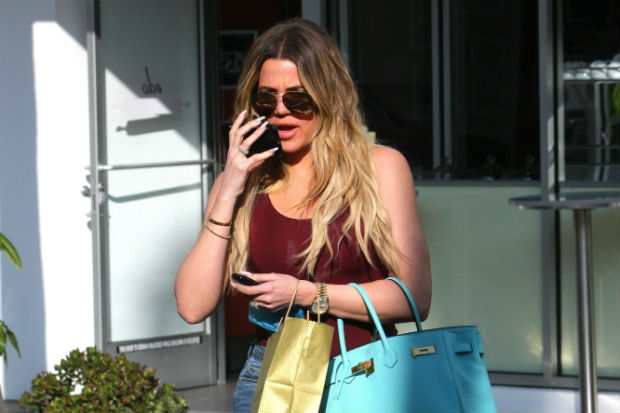 khloe kardashian red burgundy bodysuit blue hermes bag