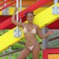 Miami Beach, FL  - *EXCLUSIVE* American singer, actress, and movie star Christina Milian was pictured as she posed in a bikini on a colorful lifeguard stand while on the beach in Miami Beach. She smiled and looked very beautiful and sexy with a cute hairstyle and make up. **SHOT ON 8/20/17**  Pictured: Christina Milian  BACKGRID USA 21 AUGUST 2017   BYLINE MUST READ: DAME / BACKGRID  USA: +1 310 798 9111 / usasales@backgrid.com  UK: +44 208 344 2007 / uksales@backgrid.com  *UK Clients - Pictures Containing Children Please Pixelate Face Prior To Publication*