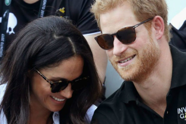 Prince Harry and Meghan Markle Pack on the PDA in Their First Official Appearance Together