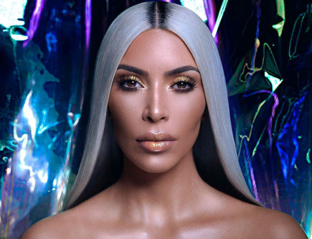 Kim Kardashian poses in nothing but glitter to promote her makeup line