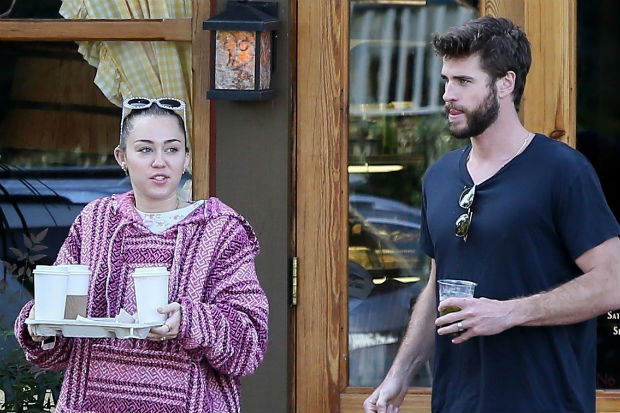 miley cyrus liam hemsworth wedding ring band engagement married