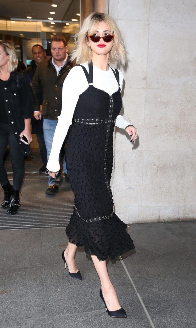 Selena Gomez black dress white long sleeve
