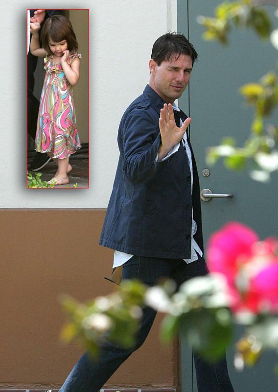Tom Cruise Takes Long Tall Suri for a Walk