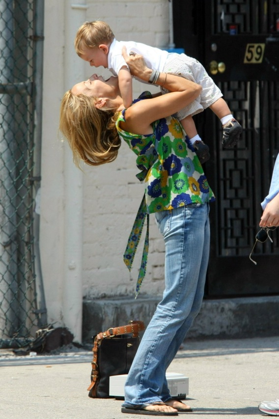 Sheryl Crow Throws Her Baby in the Air