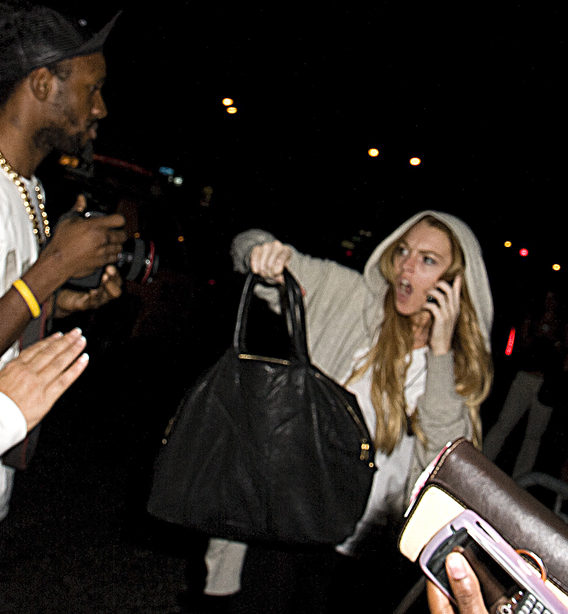 Lindsay Lohan Slugs a Photographer