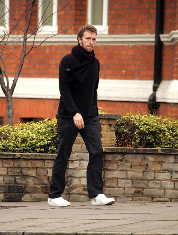 Chris Martin Punches Journalist