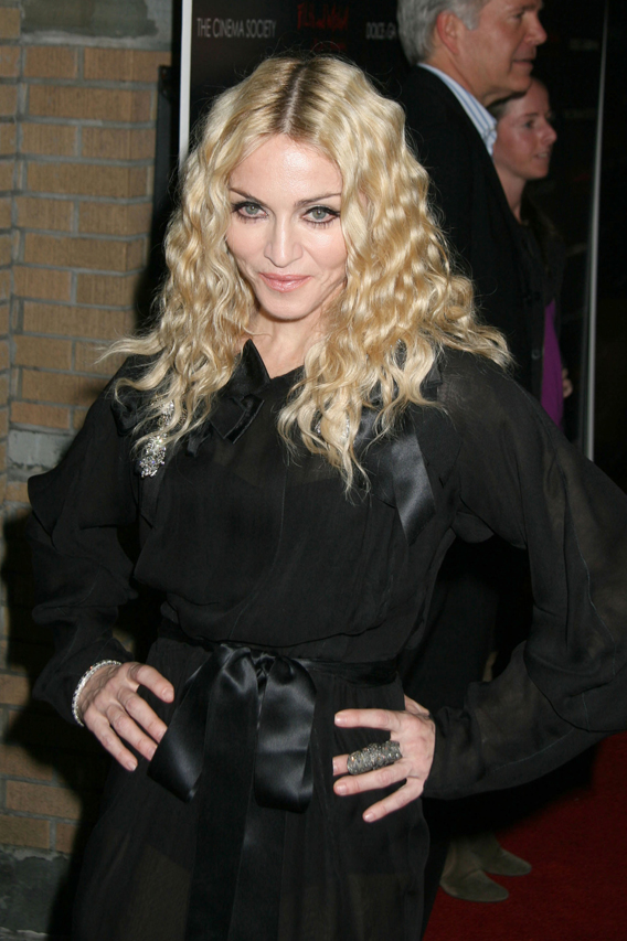 Madonna Buying Kids, Thinks She's Jesus