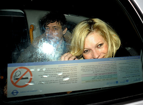 Kate Moss and Jamie Hince Hose the Press