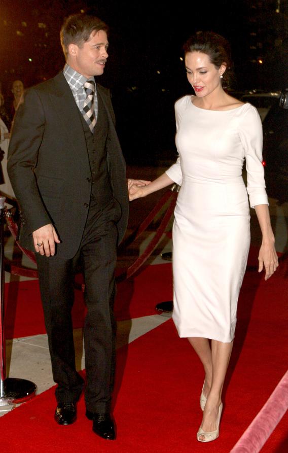 Brad Pitt and Angelina Jolie 'Button' Up