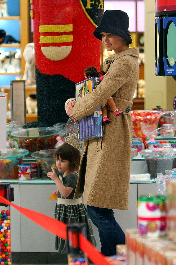 Tom Cruise and Katie Holmes Toy with Suri