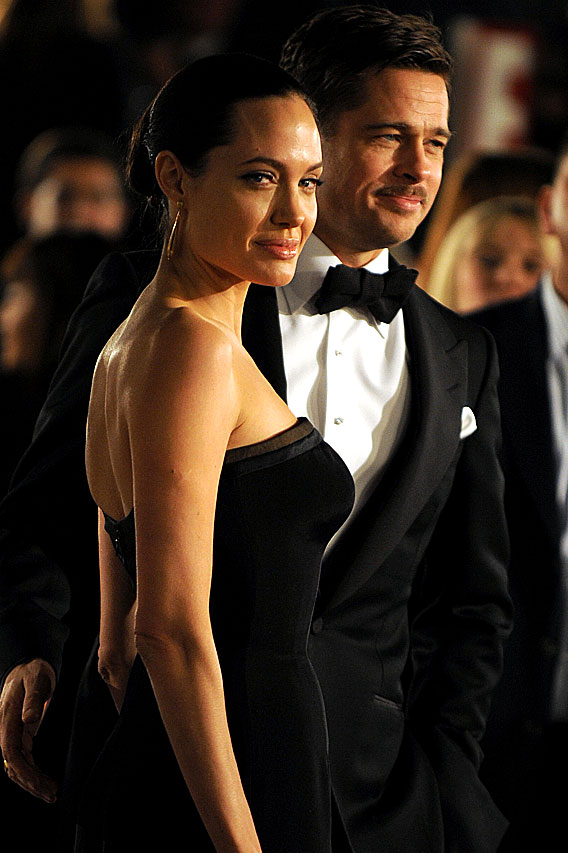 Brad Pitt and Angelina Jolie Unbutton 'Benjamin'