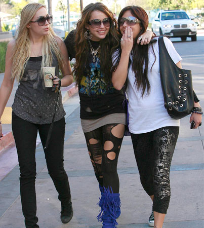 Miley Cyrus' Torn Up Tights and Boots of Blue