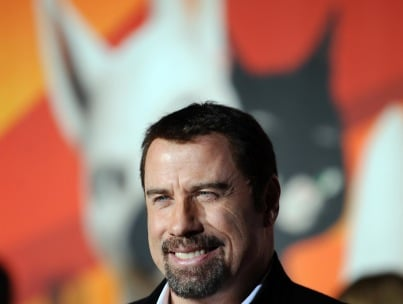 Morning Buzz: Suspects Arrested In Travolta Extortion Plot