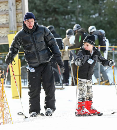 Guy Ritchie Skis Away From Madonna With Rocco