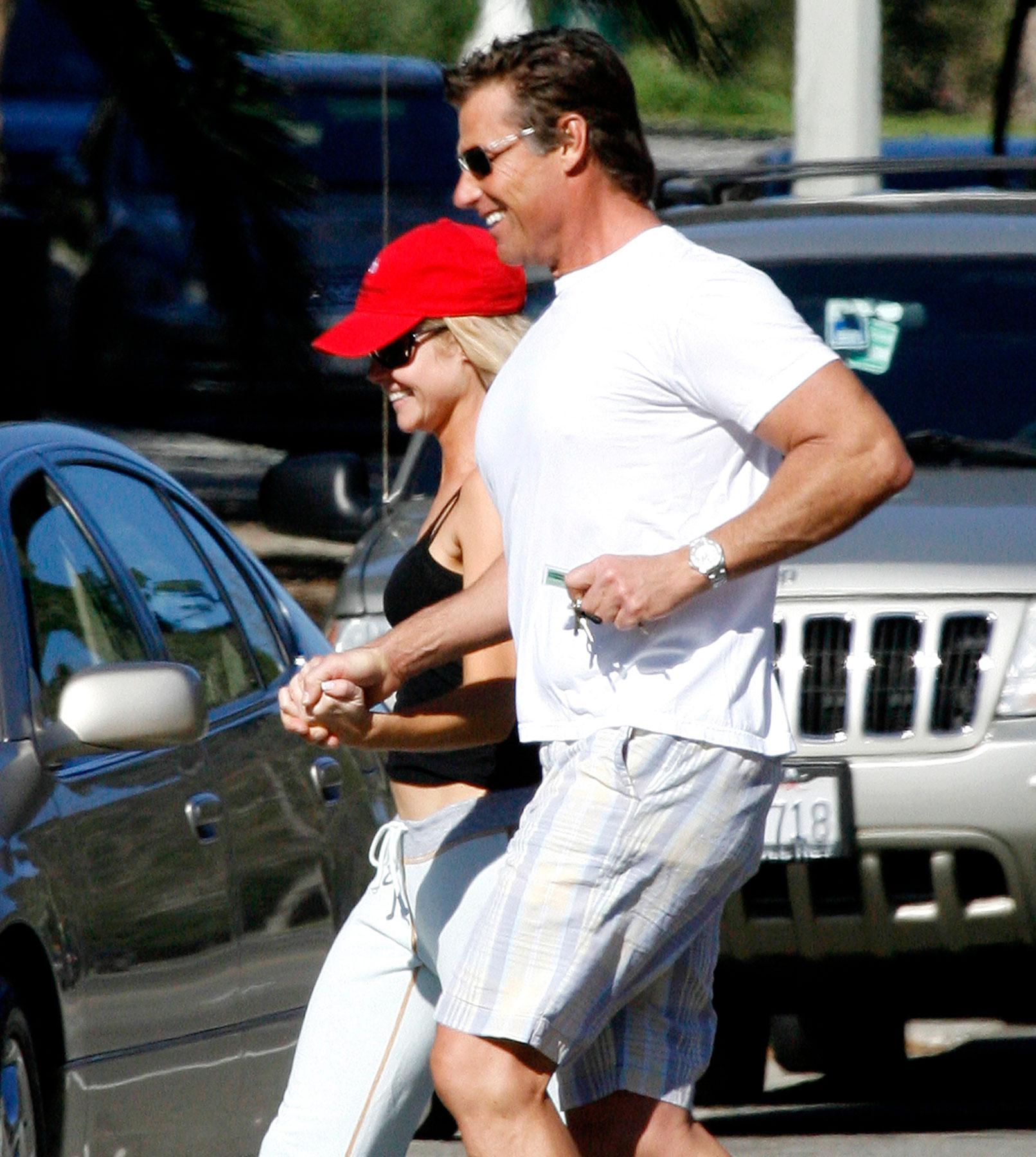 Denise Richards Gets a Hand From Her Mystery Man