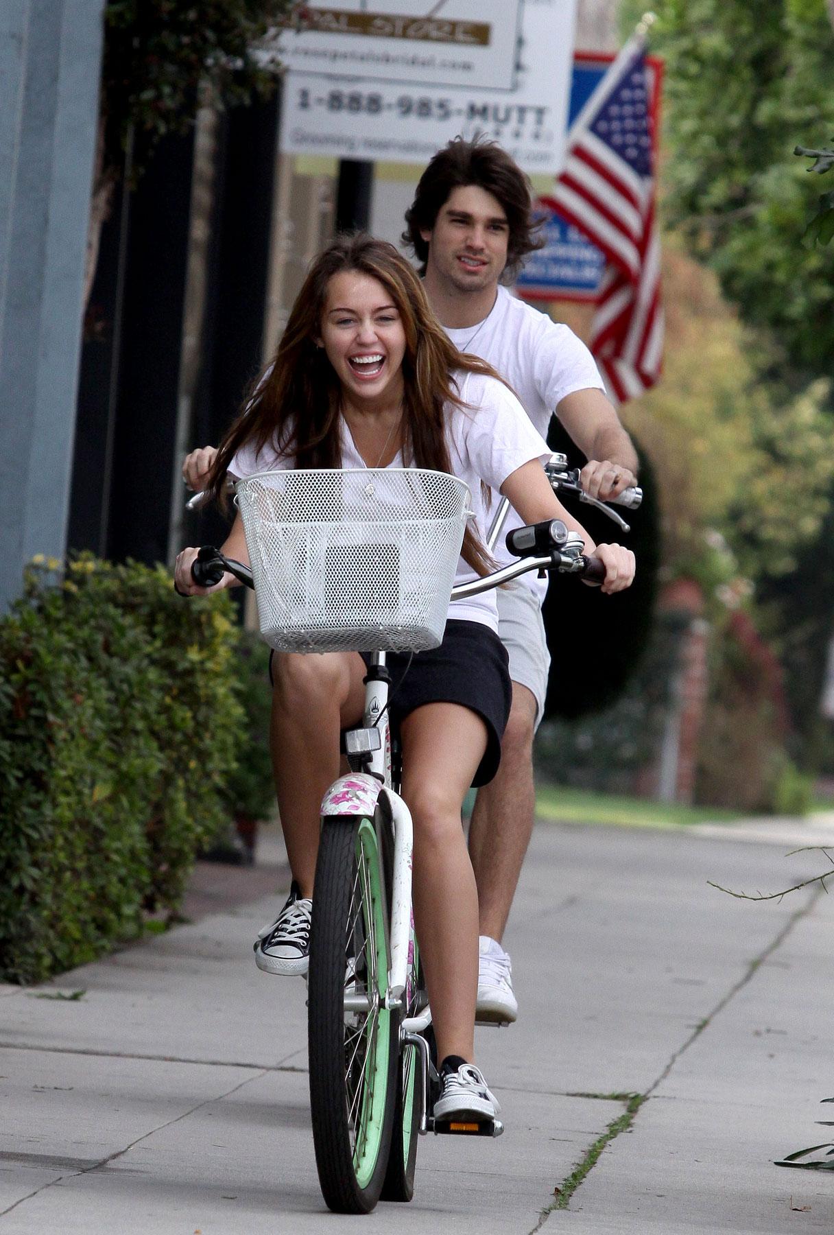 Miley Cyrus and Justin Gaston Biking