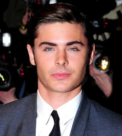 VIDEO: Zac Efron Gets Q-Tipped off by Paps