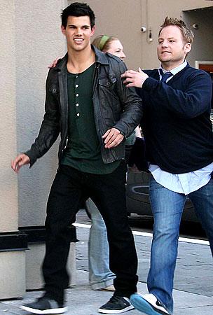Taylor Lautner Runs For Cover