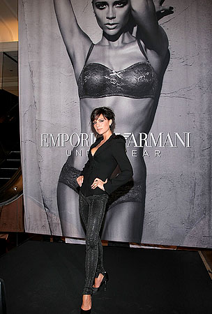 Victoria Beckham Stands in Front of Her Work