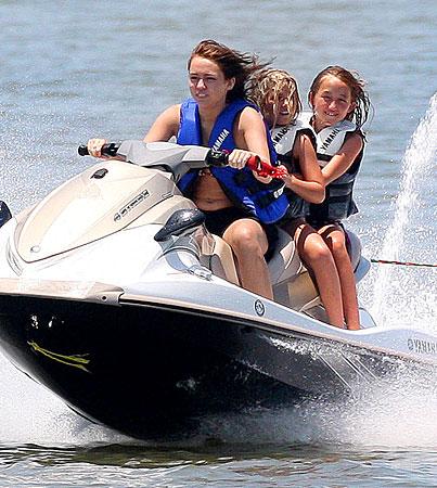 Miley Cyrus Rides The Waves Sans Nick