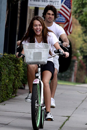 Miley Cyrus and Justin Gaston: More Tweeting, More Questions