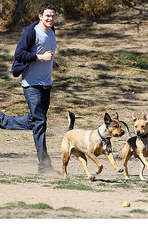 PHOTO GALLERY: Kellan Lutz Goes to the Dogs