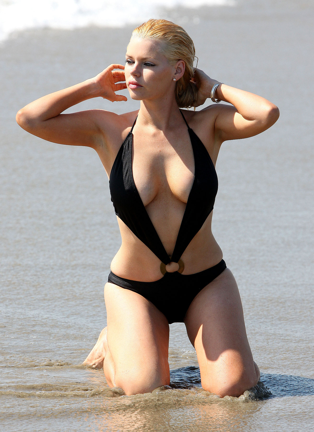 PHOTO GALLERY: Sophie Monk Takes a Dip—and Gives a Nip Slip