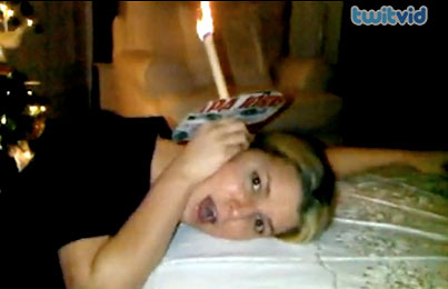 Jessica Simpson With a Candle in her Ear. Because Nothing Else Really Makes Sense Right Now, Does It? (VIDEO)