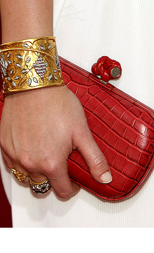 Who's Carrying This Clutch? Guess Who?! (PHOTOS)