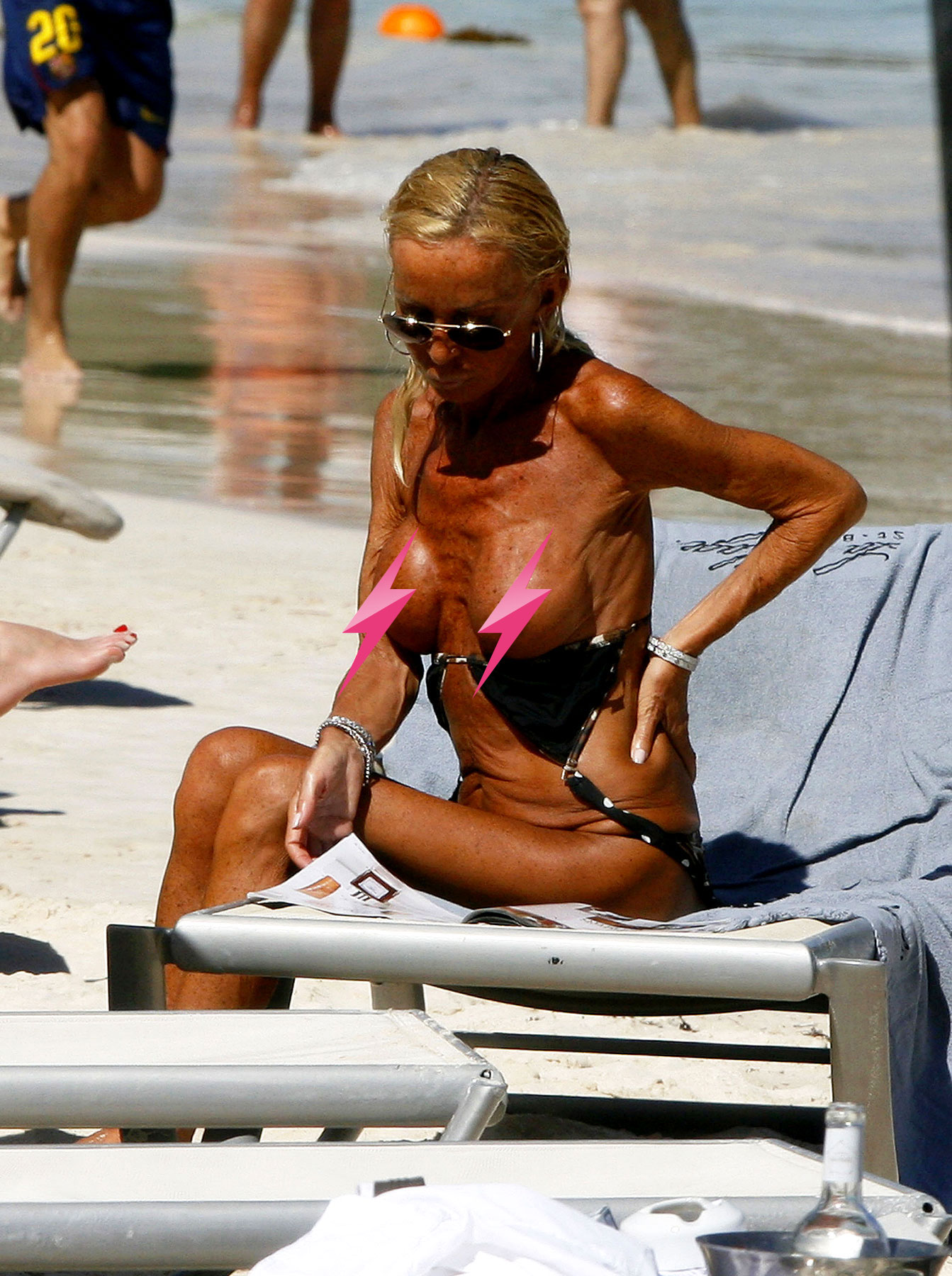 Donatella Versace Is Trying To Destroy Our Eyeballs By Sunbathing Topless (PICS)
