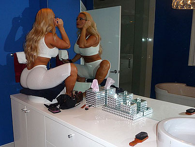 Coco Puts On Makeup Just Like You Do, Squatting On The Bathroom Counter (PHOTOS)