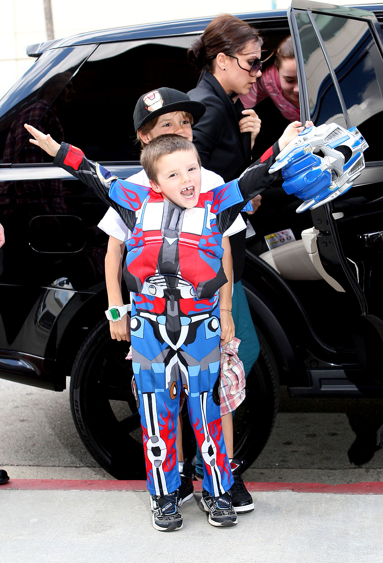 It's Cruz Beckham's Party, and He Can Dress Like Opitmus Prime if He Wants To (PHOTOS)